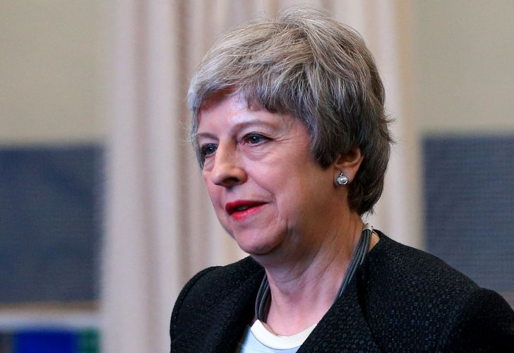 Britain's Prime Minister Theresa May gestures during a visit to the Leisure Box in Brierfield, Lancashire, on April 25, 2019, during campaigning for the local elections.