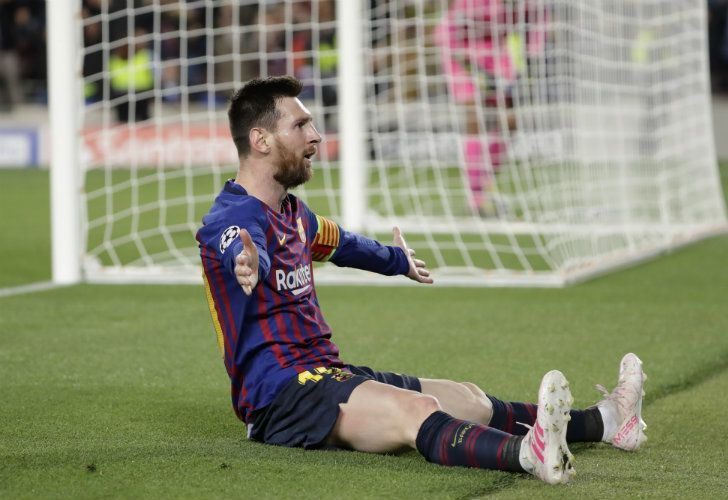 Barcelona's Lionel Messi celebrates after scoring his side's third goal during the Champions League semi-final, first leg match between FC Barcelona and Liverpool at the Camp Nou.
