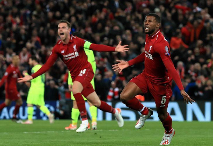 Liverpool's Georginio Wijnaldum, right, celebrates scoring his side's third goal of the game during the Champions League Semi Final, second leg soccer match between Liverpool and Barcelona at Anfield, Liverpool, England, Tuesday, May 7, 2019.