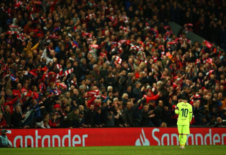 Barcelona's Lionel Messi walks back to position as Liverpool's Divock Origi celebrates scoring his side's 4th goal during the Champions League semi-final, second leg match at the Anfield stadium in Liverpool, Tuesday, May 7, 2019.