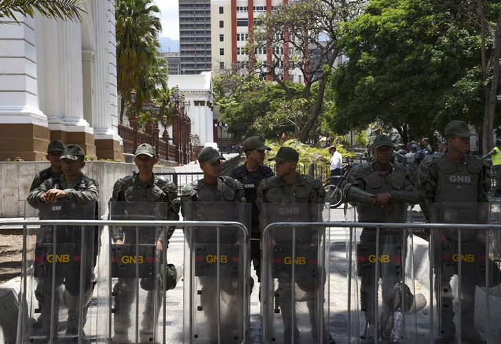 Members of the Bolivarian National Guard stand guard outside the building of the National Assembly, where a plenary session is taking place with the presency of Venezuelan opposition leader and self-declared president Juan Guaidó in Caracas, on May 7, 2019. Venezuela's Constituent Assembly, which rules the South American country with absolute powers, plans to strip parliamentary immunity from opposition lawmakers who backed a failed uprising this week, leader Diosdado Cabello said Sunday.