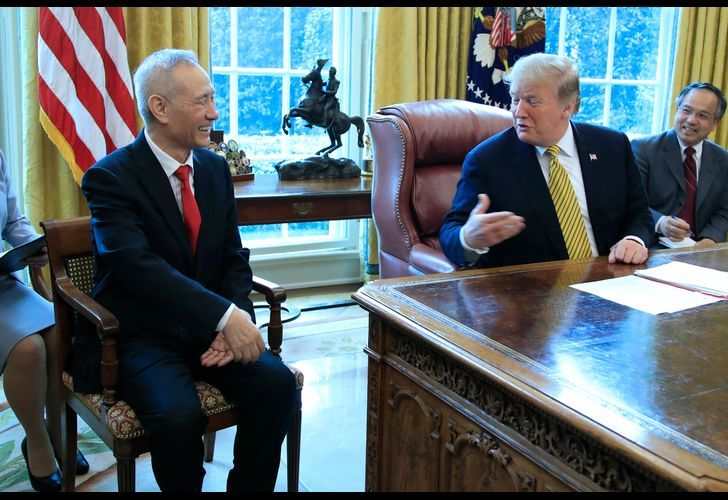 United States President Donald Trump meets with China's Vice Premier Liu He in the Oval Office of the White House in Washington DC on April 4, 2019.