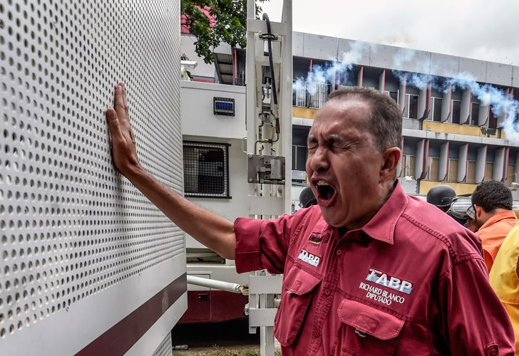In this file photo taken on June 3, 2017, Venezuelan opposition deputy Richard Blanco confronts a national guard's truck during a protest against President Nicolás Maduro's government in Caracas.